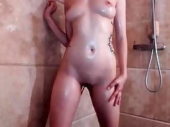 Teen having a shower and pruning in a solo movie