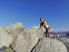 Climbing a Rock in a brief Dress