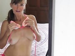 Horny mom taking off her bikini and is fingering her hairy vagina