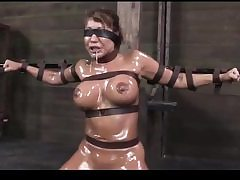Horny biotch gets tight up and decorated in lubricant about to get sexually abused