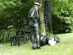 Porno dominating video with a man dressed in leather kissing feet